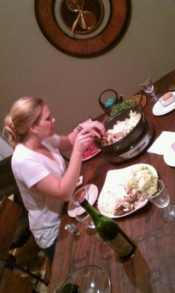 Me arranging the sukiyaki in the hotpot