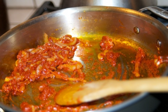 Adding tomato paste to the soffritto