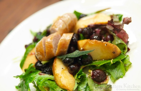 Spring forward salad with blueberries, white peaches, and rabbit sausage